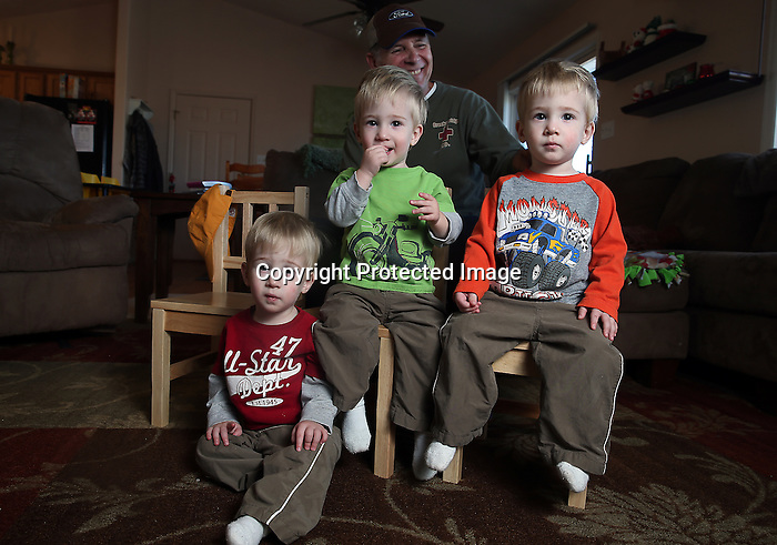 "Bill inman with his identical triplet grandsons from left, Brice, Elliott, and Cooper at Bill's son's home in December. January 30th the boys will be celebrating their 2ns birthdays. ""It's wonderful place to raise my kids and their kids."" Michael Smith/staff"