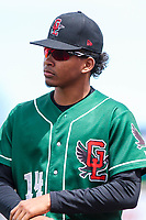 Great Lakes Loons pitcher Edwin Uceta (14) heads to the dugout prior to a Midwest League game against the Wisconsin Timber Rattlers on May 12, 2018 at Fox Cities Stadium in Appleton, Wisconsin. Wisconsin defeated Great Lakes 3-1. (Brad Krause/Four Seam Images)