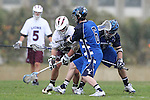 Los Angeles, CA 02/18/11 - Neil Wallace (BYU #6), Daniel Neeleman (BYU #7) and Travis Abraham (LMU #9) in action during the Loyola Marymount - BYU game at LMU.