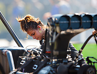 Jun 15, 2018; Bristol, TN, USA; Jasmine Salinas , daughter of NHRA top fuel driver Mike Salinas cleans the tires of the dragster working as a crew member during qualifying for the Thunder Valley Nationals at Bristol Dragway. Mandatory Credit: Mark J. Rebilas-USA TODAY Sports