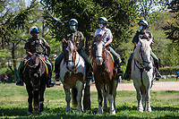 NEW YORK, NY - MAY 10: Police officers wearing face masks and on horses tour Flushing Meadows-Corona Park on Mother's Day for people to use social distance on May 10, 2020 in Queens, New York. COVID-19 has spread to most countries in the world, claiming more than 283,000 lives and more than 4.1 million people infected, Queens has been one of the places most affected by the Coronavirus. (Photo by Pablo Monsalve / VIEWpress via Getty Images)