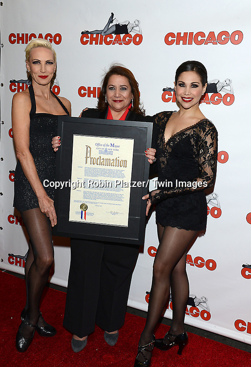 "Amra-Faye Wright  and Bianca Marroquin  with NYC Commissioner of Media and Entertaqinment  Cynthia Lopez attends ""Chicago""  becoming the 2nd Longest Running Show on Broadway at performance 7486 on November 23, 2014 at the Ambassodor Theatre in New York City."