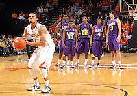 Jan. 2, 2011; Charlottesville, VA, USA; LSU Tigers players watch as Virginia Cavaliers guard Mustapha Farrakhan (2) shoots a techinical called on LSU Tigers head coach Trent Johnson during the game at the John Paul Jones Arena. Virginia won 64-50. Mandatory Credit: Andrew Shurtleff-