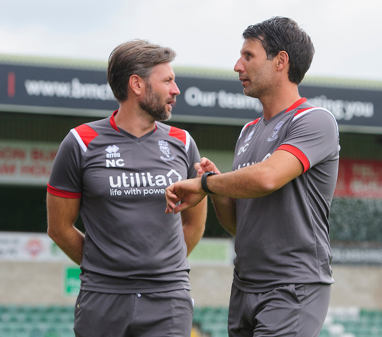 Lincoln City's assistant manager Nicky Cowley, left, and Lincoln City manager Danny Cowley<br /> <br /> Photographer Chris Vaughan/CameraSport<br /> <br /> Football Pre-Season Friendly - Lincoln City v Sheffield Wednesday - Saturday July 13th 2019 - Sincil Bank - Lincoln<br /> <br /> World Copyright © 2019 CameraSport. All rights reserved. 43 Linden Ave. Countesthorpe. Leicester. England. LE8 5PG - Tel: +44 (0) 116 277 4147 - admin@camerasport.com - www.camerasport.com