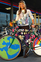 Amanda Yancey stands at the corner of Felspar and Mission Blvd with her bicycle Rainbow Warrior, Tuesday, October 30, 2007. She decorated the bicycle for the monthly Critical Mass ride that takes place on the last Friday of every month in San Diego and many other cities around the nation and the world. These rides are designed to draw attention to how unfriendly cities have become to bicycle traffic and, according to a local website for the group ?to show how things could be different?.