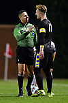 GREENSBORO, NC - DECEMBER 02: Matias Warp #17 of North Park University speaks with an official after receiving a yellow card during the Division III Men's Soccer Championship held at UNC Greensboro Soccer Stadium on December 2, 2017 in Greensboro, North Carolina. Messiah College defeated North Park University 2-1 to win the national title. (Photo by Grant Halverson/NCAA Photos via Getty Images)