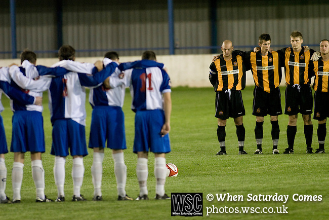 16.09.2008 Leek, England. The players of Leek Town (blue) and Clitheroe observing a minute's silence on the pitch prior to the clubs FA Cup 1st Qualifying Round replay at Harrison Park, Leek. The first match ended in a one-all draw but it was Clitheroe who progressed to the next round winning the replay one-nil, despite having a man sent off in the second half. The preliminary stages of the FA Cup were used to determine which non-League clubs were included in the first round proper of the FA Cup. Photo by Colin McPherson.