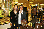 "Assistant Lisa and Days - Kristen Alfonso with jewelry line Hope - Faith - Miracles on November 29, 2008 at Bloomingdales, New York City, New York. ""The fleur de lis has been the symbol of my inspiration. It has brought me hope and the faith to believe in miracles."" (Photo by Sue Coflin/Max Photos)"