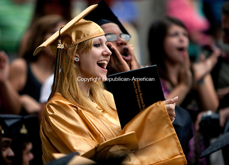BEACON FALLS, CT 22 JUNE, 2010-062210JS06-Woodland Regional High School graduate Kylynn Salerno cheers on gellow graduates as diplomas are presented during commencement Tuesday at Woodland Regional High School in Beacon Falls.<br /> Jim Shannon Republican-American