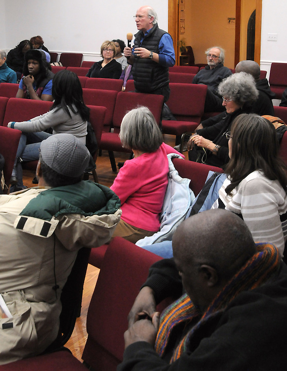 Peter Heymann, of ENJAN, questioning, Kingston Mayor, Steve Noble and Police Chief Egidio F. Tinti, at a Community Policing Forum, sponsored by the Kingston Branch of ENJAN and the Ministers Alliance of Ulster Co., held at New Progressive Baptist Church, on Hone Street in Kingston, NY, on Tuesday, December 13, 2016. Photo by Jim Peppler; Copyright Jim Peppler 2016.