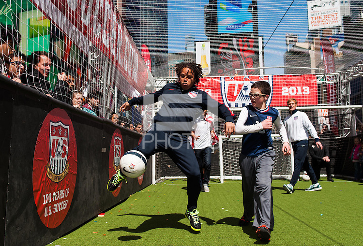 Former men's national team player Cobi Jones plays the ball during a small sided game during the centennial celebration of U. S. Soccer at Times Square in New York, NY, on April 04, 2013.