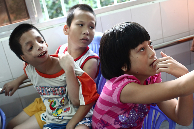 Disabled children interact with members of Veterans for Peace in the Agent Orange children's ward of Tu Du Hospital in Ho Chi Minh City, Vietnam.  About 500 of the 60,000 children delivered each year at the maternity hospital, Vietnam's largest, are born with deformities, some because of Agent Orange, according to doctors. May 1, 2013.