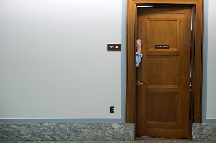 UNITED STATES - FEBRUARY 14:  A man holds a door open in Dirksen Building.  (Photo By Tom Williams/CQ Roll Call)