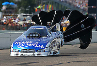 Aug 16, 2014; Brainerd, MN, USA; NHRA funny car driver Tommy Johnson Jr during qualifying for the Lucas Oil Nationals at Brainerd International Raceway. Mandatory Credit: Mark J. Rebilas-