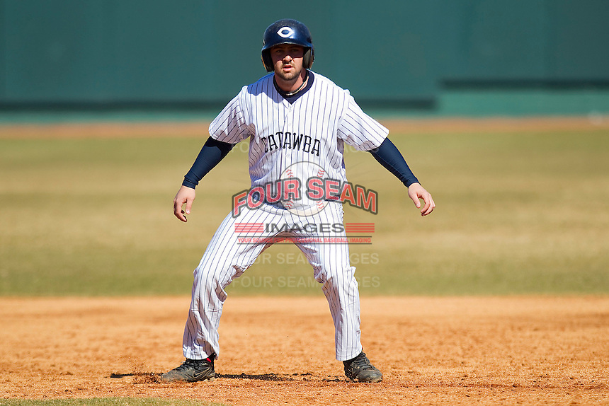 Garrett Furr #23 of the Catawba Indians takes his lead off of first base against the Shippensburg Red Raiders at Newman Park on February 12, 2011 in Salisbury, North Carolina.  Photo by Brian Westerholt / Four Seam Images