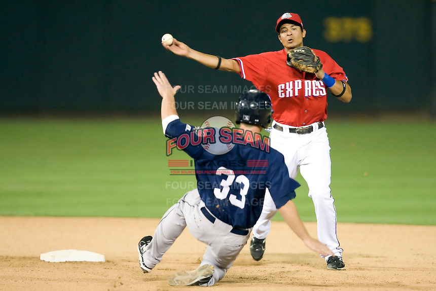 Round Rock Express shortstop Guilder Rodriguez #1 turns a double play during a game against the New Orleans Zephyrs at the Dell Diamond on July 20, 2011 in Round Rock, Texas.  New Orleans defeated Round Rock 14-11.  (Andrew Woolley/Four Seam Images)