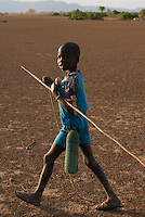 ETHIOPIA, Southern Nations, Lower Omo valley, Kangaten, village Kakuta, Nyangatom tribe, young shepherd / AETHIOPIEN, Omo Tal, Kangaten, Dorf Kakuta, Nyangatom Hirtenvolk, Hirtenjunge