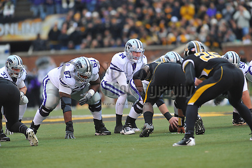 Nov 13, 2010; Columbia, MO, USA; Kansas State Wildcats quarterback Carson Coffman (14) goes under center in the first half of the game against the Missouri Tigers at Memorial Stadium. Mandatory Credit: Denny Medley-US PRESSWIRE