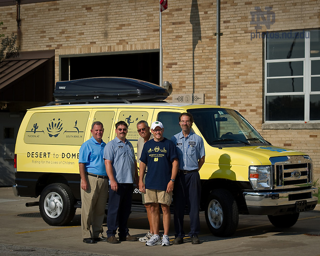 University of Notre Dame College of Science dean Greg Crawford, second from right, poses with Notre Dame Transportation Services staff in front of a support van that will follow Dean Crawford and his wife Renate as they bike from Tucson, AZ to Notre Dame in July and August of 2010 to raise awareness of Notre Dame's new partnership with the Ara Parseghian Medical Research Foundation...Photo by Matt Cashore/University of Notre Dame