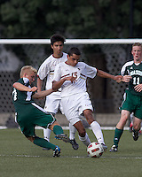 Boston College forward/midfielder Diego Medina-Mendez (15) dribbles as George Mason University defender George Mason University midfielder Verneri Valimaa (7) defends. Boston College defeated George Mason University, 3-2, at Newton Soccer Field, August 26, 2011.