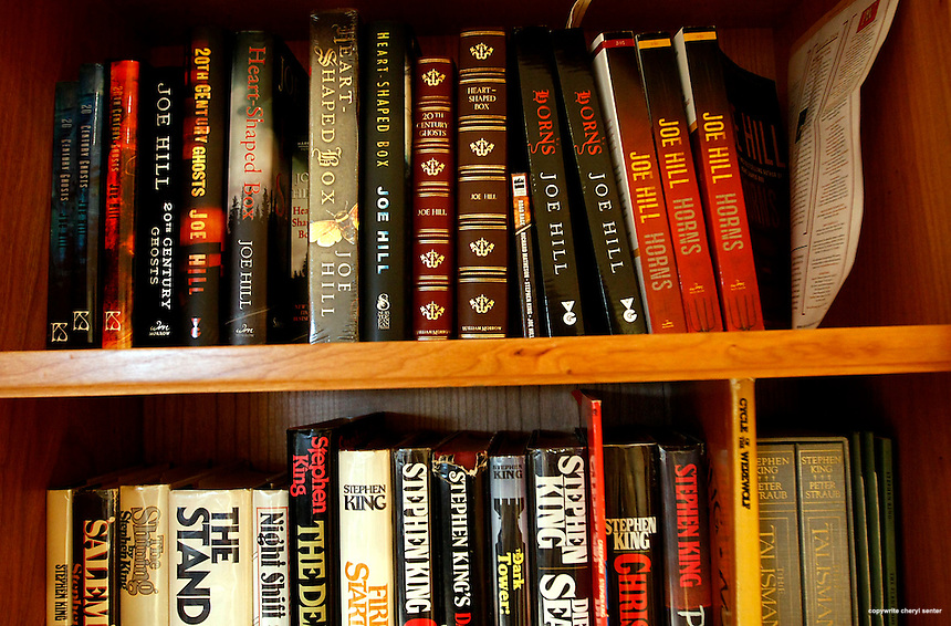 A bookshelf filled with author Joe Hill's work, and his dad's, Stephen King, at home in Southern N.H., Friday, March 12, 2010.  (Cheryl Senter for the Boston Globe)