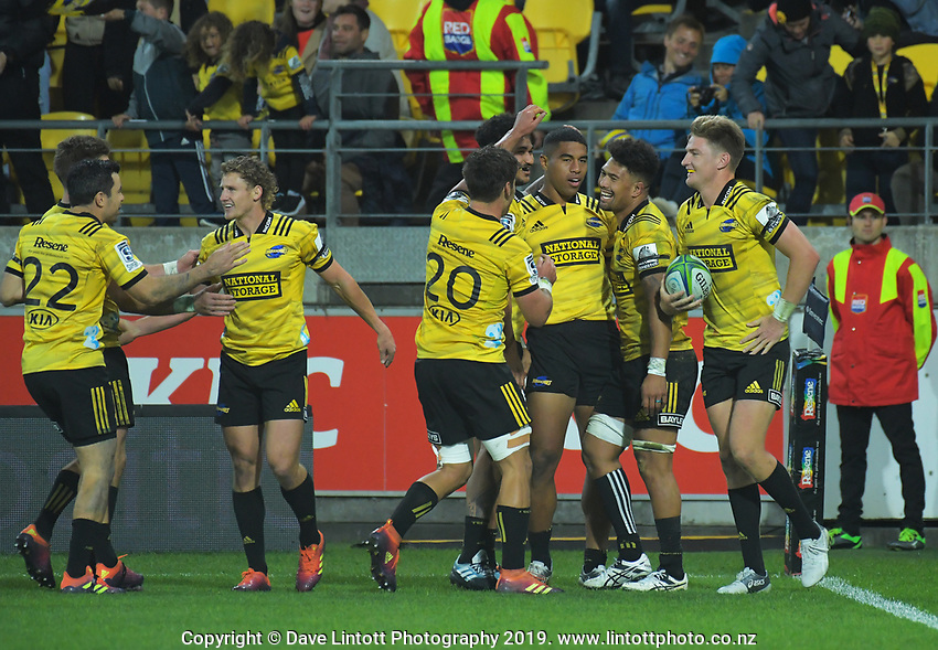 The Hurricanes congratulate Hurricanes' Salesi Rayasi on his try during the Super Rugby match between the Hurricanes and Chiefs at Westpac Stadium in Wellington, New Zealand on Friday, 27 April 2019. Photo: Dave Lintott / lintottphoto.co.nz