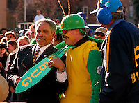 PHILADELPHIA - JANUARY 1:  Philadelphia Mayor John F. Street (L) poses for photos with a comic club member, dressed as a bug, whose theme made light of the investigation into the Mayor's administration in 2003, during the 103rd New Year's Day Mummer's Parade January 1, 2004 in Philadelphia, Pennsylvania. The day long parade features four divisions which are Comics, Fancy Clubs, Fancy Brigades, and String Bands. The clubs develop a theme, create costumes, build sets and props, and coreograph musical and dance numbers while competing for $386,000 in prizes. (Photo by William Thomas Cain/Getty Images).