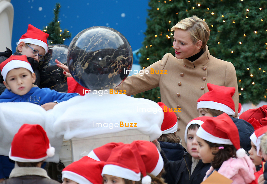 Princess Charlene of Monaco and Prince Albert II of Monaco attend the Christmas Celebration For Monaco Children on December 12, 2012 in Monaco, Monaco.  .