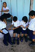 Osa Peninsula, Costa Rica. Schoolchildren at the Escuela el Refugio Drake primary school on Drake Bay eating lunch.