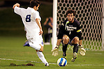 26 Sept 2006,  John DiRaimondo (8) of SLU winds up to take a shot on goal as MSU goalie Lance Parker gets into position to block the shot.  The St. Louis University Billikens defeated the Missouri State University Bears by a score of 1-0 in a regular season conference match at Robert R. Hermann Stadium, St. Louis, Missouri.