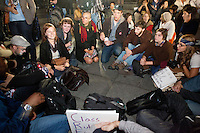"Protesters with the ""Occupy Wall Street"" movement gather in small groups in Washington Square Park on October 15, 2011 in New York City to decide whether or not to ""occupy"" the park.  After a largely frustrating (and occasionally dangerous) encounter with the police department after a march to Times Square thousands of protesters joined up in Washington Square park where they tried to collectively decide on whether or not to ""occupy"" Washington Square Park that night despite its curfew of midnight.  Shortly before the appointed hour it is agreed to meet on the subject the next night, although more than a dozen protesters do end up staying in the park regardless and are summarily arrested."