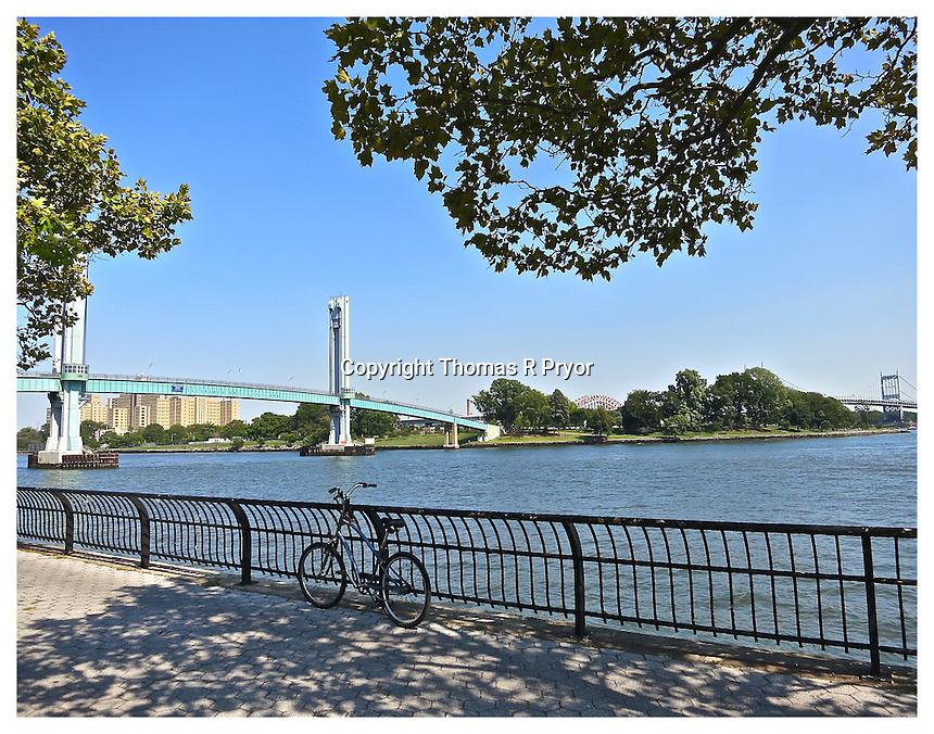 NEW YORK, NY - AUGUST 31: Bike on 103rd Street walking bridge to island in Yorkville, New York on August 31, 2013. Photo Credit: Thomas R Pryor