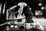 A wrestler gets some medical attention for his bloodied face during a bout  at Doglegs, an event for wrestlers with physical and mental challenges in Tokyo, Japan.