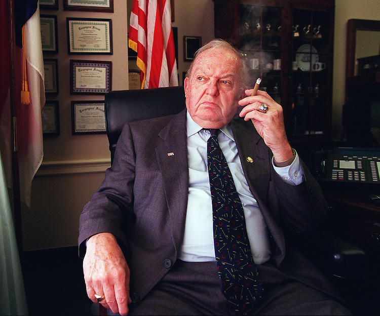 10/4/97.Congressmen Howard Coble,R-N.C., smokes in his office in the Rayburn House office Building..CONGRESSIONAL QUARTERLY PHOTO BY DOUGLAS GRAHAM