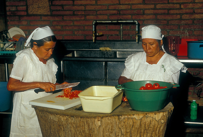 Cooks preparing food at La Capilla Restaurant, Zaachila, Oaxaca State, Mexico, North America