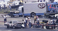 Terry Bivins #91 Chevrolet 24th place finish reapairs pits pit stop STP transporter garage background Southern 500 Darlington Raceway, Darlington SC, September 5, 1977.(Photo by Brian Cleary/www.bcpix.com)