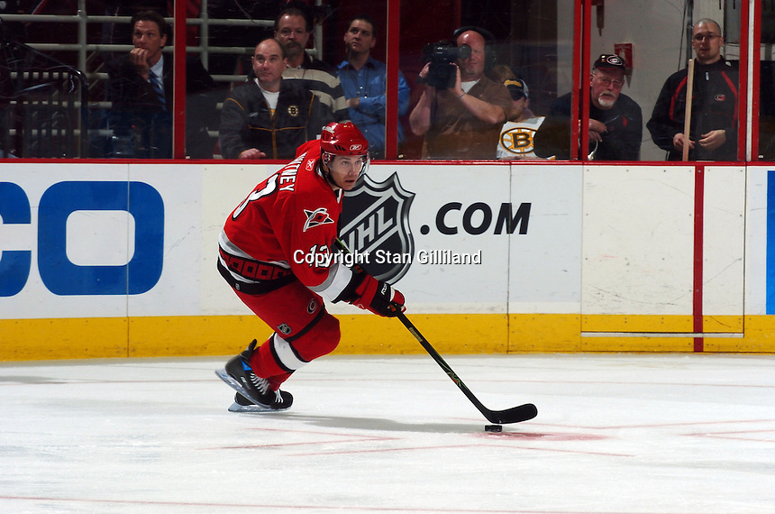 Carolina Hurricanes' Ray Whitney looks up ice during a game with the  Boston Bruins at the RBC Center in Raleigh, NC Wednesday, March 1, 2006. The Hurricanes won 4-3...