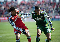 26 March 2011: Toronto FC forward Javier Martina #33 and Portland Timbers defender/midfielder Rodney Wallace #22 in action during an MLS game between the Portland Timbers and the Toronto FC at BMO Field in Toronto, Ontario Canada..Toronto FC won 2-0....