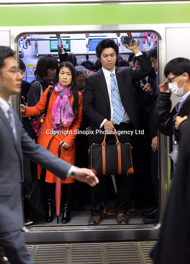 Passengers packed on a train in Shinjuku Station, Tokyo, Japan. With up to 4 million passengers passing through it every day, Shinjuku station, Tokyo, Japan, is the busiest train station in the world. The station was used by an average of 3.64 million people per day.  That's 1.3 billion a year.  Or a fifth of humanity. Shinjuku has 36 platforms, and connects 12 different subway and railway lines.  Morning rush hour is pandemonium with all trains 200% full. <br /> <br /> Photo by Richard jones / sinopix