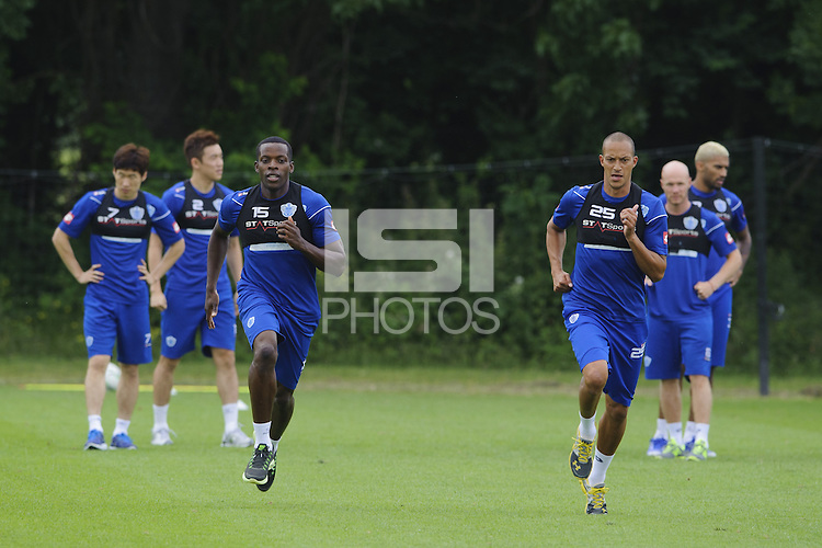 Bobby Zamora and Nedum Onuoha with the QPR team in training