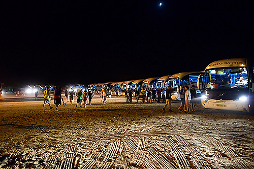 A fleet of buses transport U.S. athletes and staff at the 19th Maccabiah games in Israel.