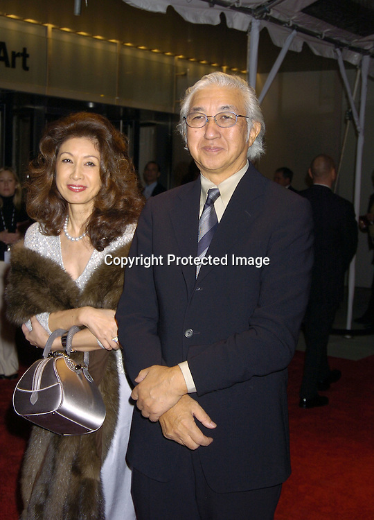 Yoshio Tanaguchi and wife Kumi..at the Re-opening party  for The Museum of Modern Art on ..November 18, 2004 in New York City. ..Photo by Robin Platzer, Twin Images