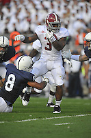 10 September 2011:  Alabama RB Trent Richardson (3) runs through a tackle by Penn State's D'Anton Lynn (8). The Alabama Crimson Tide defeated the Penn State Nittany Lions 27-11 at Beaver Stadium in State College, PA..