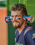 29 June 2014:  Vermont Lake Monsters outfielder Dayton Alexander devises a way to hear more effectively during a game against the Lowell Spinners at Centennial Field in Burlington, Vermont. The Lake Monsters fell to the Spinners 7-5 in NY Penn League action. Mandatory Credit: Ed Wolfstein Photo *** RAW Image File Available ****