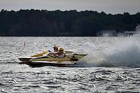 "Jim Houle, E-143 ""Macaroni"" (1970 Ron Jones 280 class cabover hydroplane) and Harry Holst, E-160 ""Heatwave"" (1960's Whiteman 280 class cabover hydroplane)"