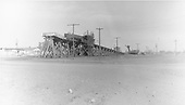 D&amp;RGW Antonito coaling trestle from southwest.  The Red Devil coal loader is in the distance and will replace the trestle's function.<br /> D&amp;RGW  Antonito, CO  Taken by Miller, Neal R. - ca. 1956