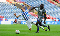 Lincoln City's John Akinde vies for possession with Huddersfield Town's Jon Gorenc Stankovic<br /> <br /> Photographer Chris Vaughan/CameraSport<br /> <br /> The Carabao Cup First Round - Huddersfield Town v Lincoln City - Tuesday 13th August 2019 - John Smith's Stadium - Huddersfield<br />  <br /> World Copyright © 2019 CameraSport. All rights reserved. 43 Linden Ave. Countesthorpe. Leicester. England. LE8 5PG - Tel: +44 (0) 116 277 4147 - admin@camerasport.com - www.camerasport.com
