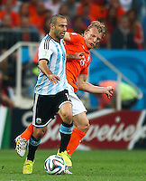 Former Liverpool team mates Javier Mascherano of Argentina and Dirk Kuyt of Netherlands in action