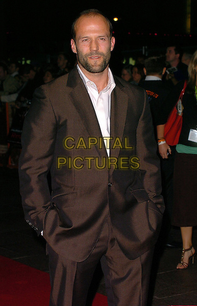 "JASON STATHAM.Arrivals at The ""Revolver"" world premiere held at The Odeon Cinema, Leicester Square,.London, 20th September 2005.half length brown shiney suit hands pockets.Ref: CAN.www.capitalpictures.com.sales@capitalpictures.com.©Capital Pictures"
