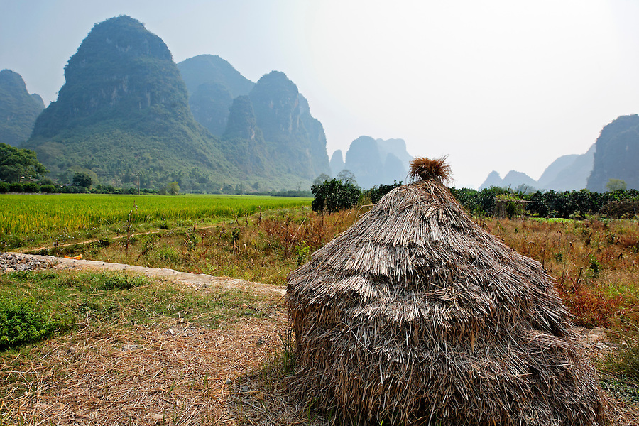 Pile of hay in Yulang River valley, Yangshuo, Guanxi, China